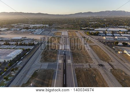 Los Angeles, California, USA - July 21, 2016:  Late afternoon light on the runway at Van Nuys airport in the San Fernando Valley.