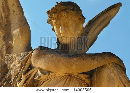 angel in the sunlight (an antique statue)