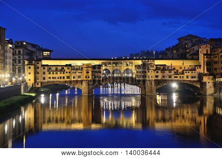 FLORENCE, ITALY - APRIL 27: Ponte Vecchio arch bridge over the Arno River on April 27, 2013 in Florence, Italy. It is the only bridge in Florence, has retained its original appearance since 1345 year