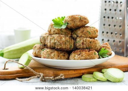 Meat cutlets with zucchini homemade food recipe of minced meat with vegetables selective focus