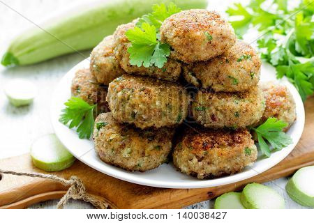 Meat cutlets with zucchini and and green herbs selective focus