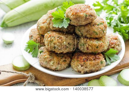 Pork meat cutlets with zucchini and parsley selective focus