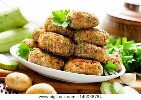 Delicious homemade cutlets with a golden crispy crust of bread crumbs on dining table selective focus