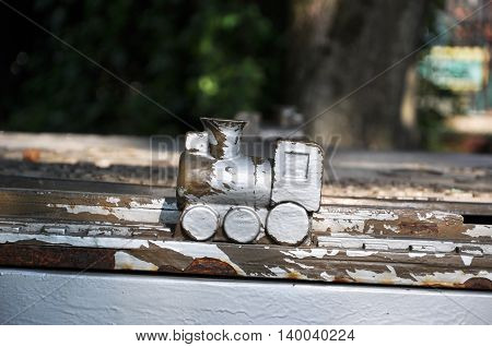 wooden train in a Park. with peeling paint