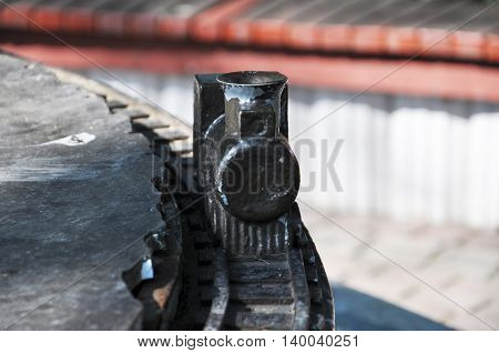a small wooden train on the rails. with peeling paint