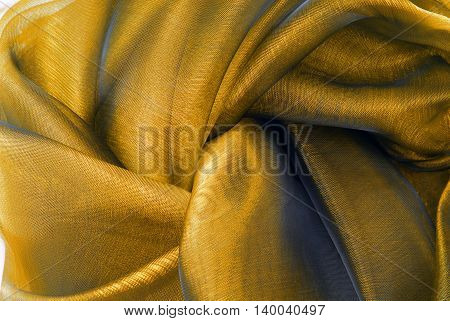 close up of the gold wavy organza fabric
