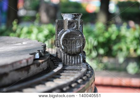 wooden train on the rails. with peeling paint