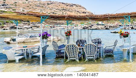 A unique Greek family tavern with tables in the sea. Located in the picturescue