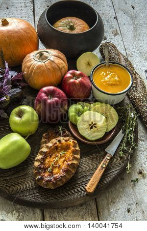 Red and green apples, squash, bread, thyme, basil, puree in a Cup