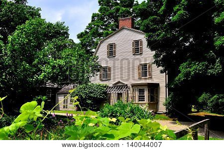 Concord Massachusetts - July 9 2013: 1770 Olde Manse and gardens in Minuteman National Historic Park once home to noted American authors Ralph Waldo Emerson and Nathaniel Hawthorne *