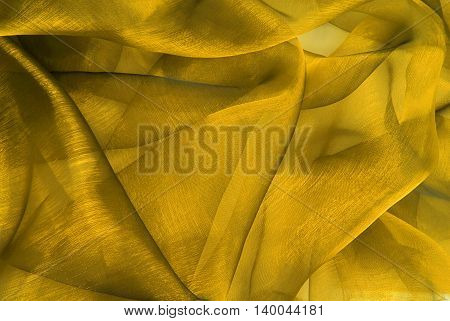 close up of the wavy yellow organza fabric