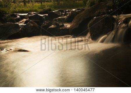 Waterfall In A Small Country Stream. Long Exposure.