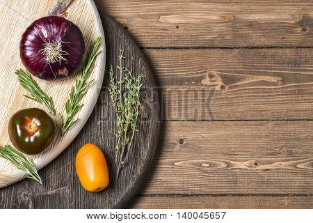 Red onions on rustic wooden Board, place for text