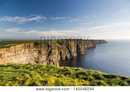 Famous cliffs of Moher at sunset in Co. Clare Ireland
