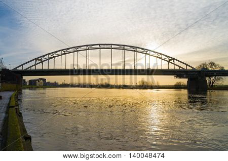 steel arch bridge over the IJssel river at Deventer in the netherlands