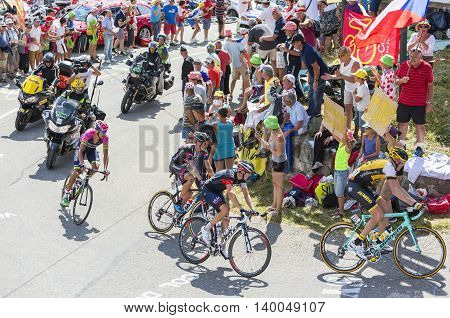 Col du Glandon France - July 23 2015: Group of cyclists riding in a beautiful curve at Col du Glandon in Alps during the stage 18 of Le Tour de France 2015.