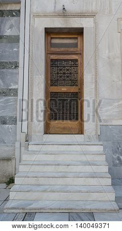 Entrance to the house with white marble staircase