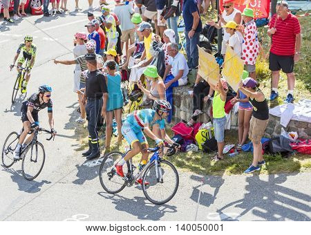 Col du Glandon France - July 23 2015: The Italian cyclist Vincenzo Nibali of Astana Team riding in a beautiful curve at Col du Glandon in Alps during the stage 18 of Le Tour de France 2015.
