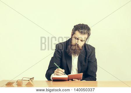 Bearded Man Teacher At Table