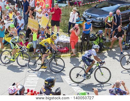 Col du Glandon France - July 23 2015: A group of favorites cyclists including Chris Froome in Yellow Jersey riding in a beautiful curve at Col du Glandon in Alps during the stage 18 of Le Tour de France 2015.