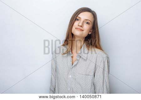 Portrait Of Happy Young Beautiful Woman In Big Shirt Posing Against White Studio Background