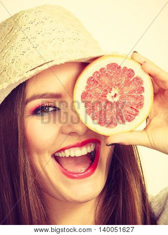 Woman Holding Half Of Grapefruit Citrus Fruit In Hand