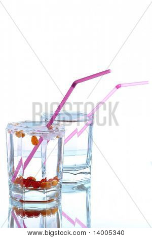 Glasses with water berries and straws