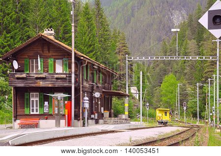 Railway station in the mountain forest. Switzerland.