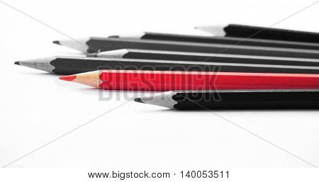 Pencils: the different one. isolated on white