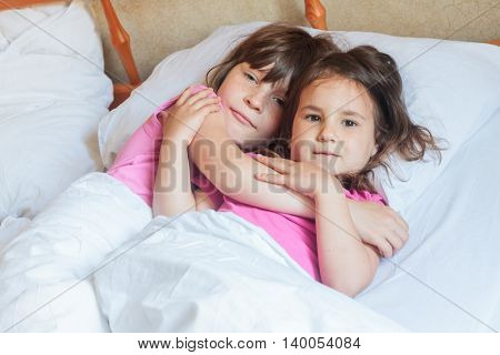 young children - boy and girls - sleeping in bed at home, indoor portrait