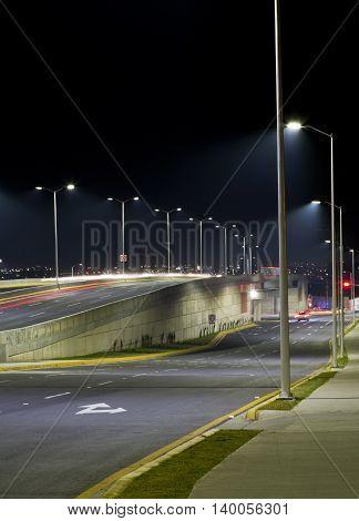 Empty bridge towers and street lights at night in Guadalajara Mexico freeway.