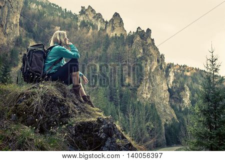 Woman hiking around mountains at spreeng time.