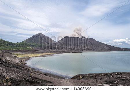 Mount Tavuruvur volcanic eruption. Tavurvur iis an active stratovolcano that lies near Rabaul, on the island of New Britain, in Papua New Guinea.