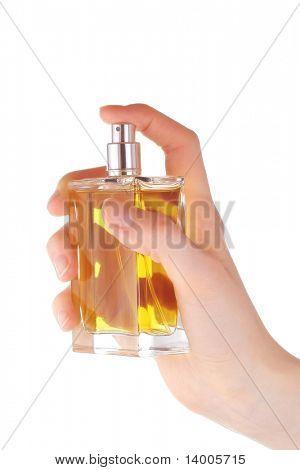 Yellow perfume in hand