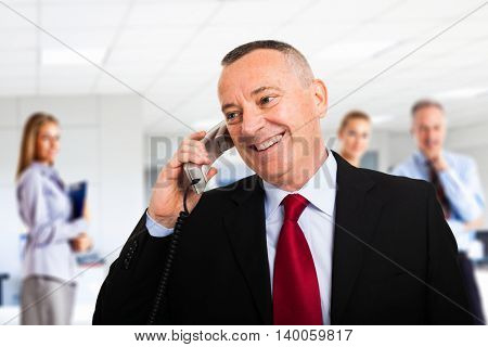 Portrait of a senior businessman talking on the phone