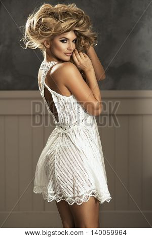 Beautiful Sensual Blonde Woman With Long Curly Hair In White Dress. Beauty Photo.