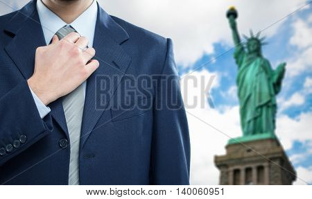 Businessman in front of the Statue of Liberty