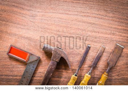 old & grunge set of hand tools many for carpentry on wood floor Copy space background.