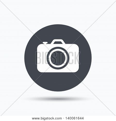Camera icon. Professional photocamera symbol. Flat web button with icon on white background. Gray round pressbutton with shadow. Vector