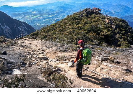 Ranau,Sabah,Borneo-March 13,2016:Climber move down from Low's Peak to Laban Rata check point at Mountain Kinabalu on 13th Mac 2016.There are two summit trails,Ranau Trail & Kota Belud Trail.