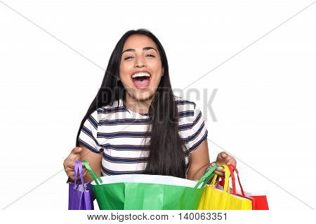 Young beautiful woman holding shopping bags. Isolated white background.