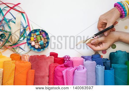 Rolls Of Bright Colored Fabric On A White Background.