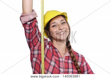 Close up of beautiful woman construction worker taking measures with a measuring tape Isolated white background.