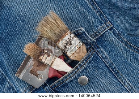 paint brushes in jeans pocket. paint brushes in jeans pocket.
