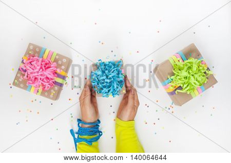Preparation for the holiday. Gifts wrapped in colorful packaging.