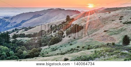 Sunset over Russian Ridge Open Space Preserve. Santa Cruz Mountains Panoramic view in California.