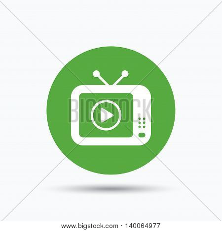 TV icon. Retro television symbol. Flat web button with icon on white background. Green round pressbutton with shadow. Vector