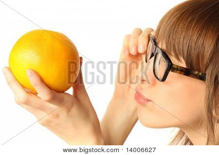 Young woman in big glasses looking to orange