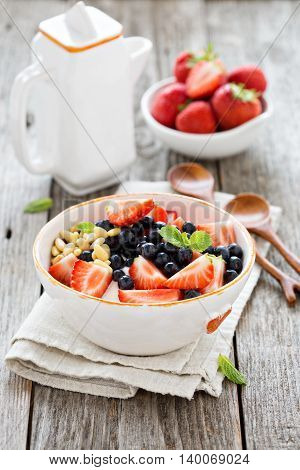 Greek yogurt bowl with fresh berries and pine nuts