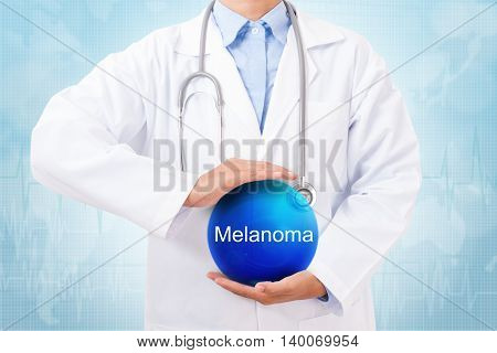Doctor holding blue crystal ball with melanoma sign on medical background.